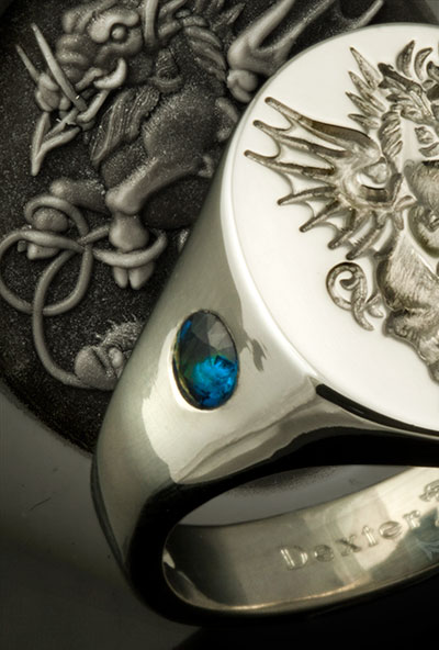 Crest Ring Set With Large Impact Sapphires in the Shoulders
