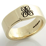 Gold wedding band with a monogram