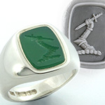 Green agate & silver ring engraved with an arm in armour heraldic crest