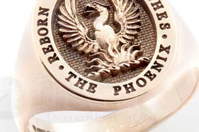 Phoenix rising from the flames - an elevated crest design on a red gold ring