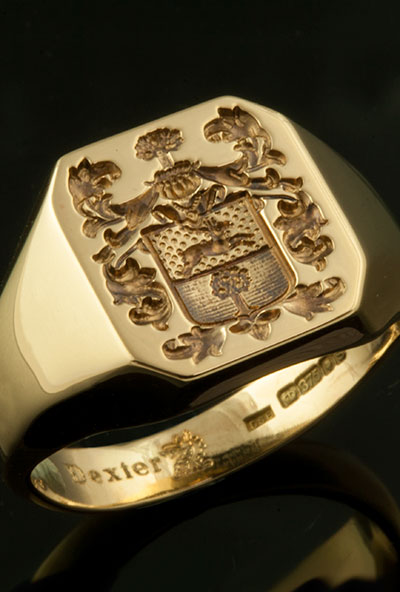 Bespoke coat of arms on an ocagonal gold signet ring