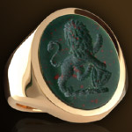 Bloodstone ring engraved with an heraldic lion rampant guardant holding a shield