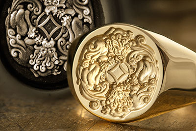 signet ring with two chinese dragons entwined