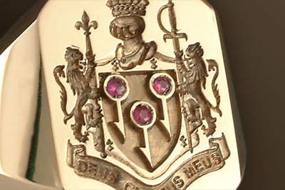 Rubies Designed ino this Bespoke Coat of Arms Ring