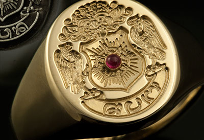 Engraved Around This Solitaire Ruby Complimenting this Client Imagined Balinese 'Family Arms' Style Ring