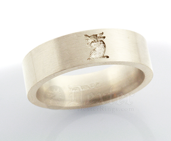 Small wedding band with heraldic crest