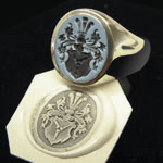 Sardonyx signet ring engraved with a traditional family coat of arms